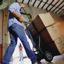 Value City Furniture – American Signature Furniture distribution employee moving boxes